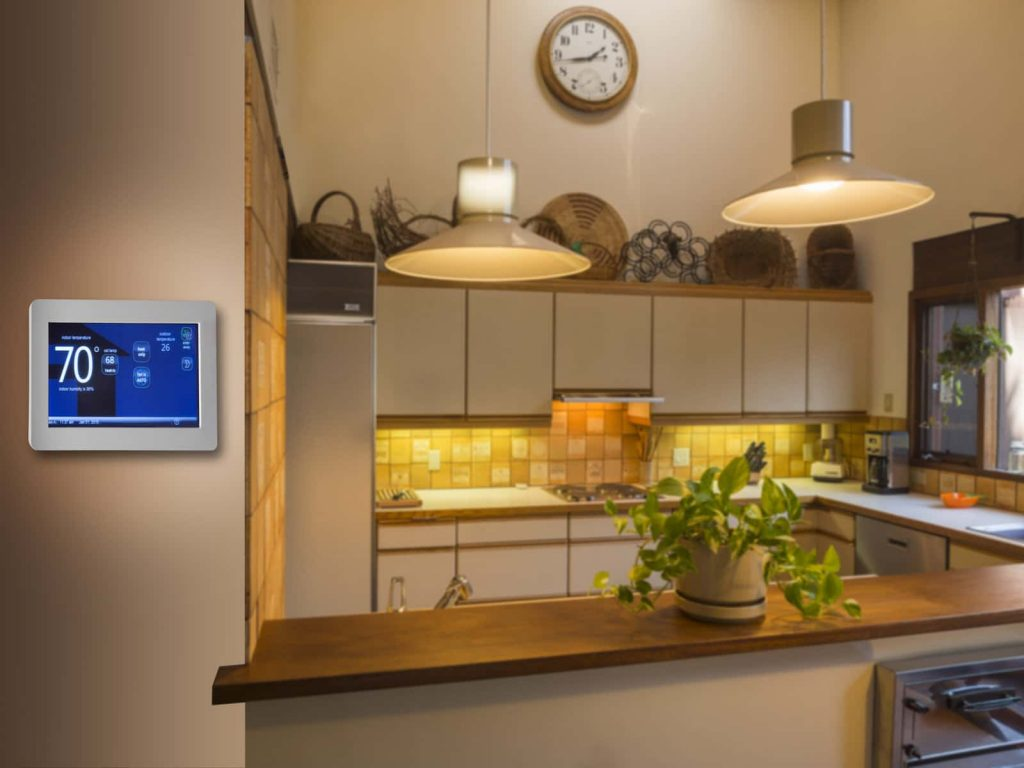 A smart thermostat in a kitchen.