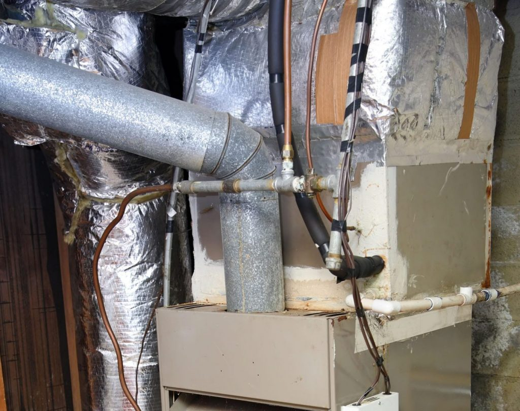 If your furnace looks like this, it's definitely time for some furnace replacement.