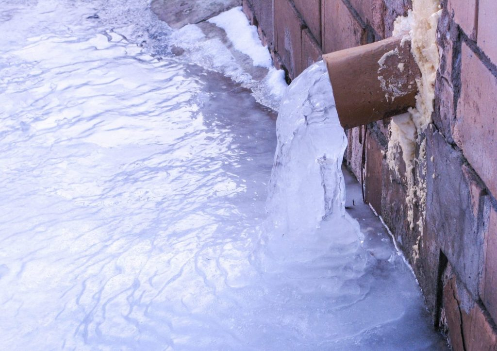 cleaning gutters in winter can help avoid ice dams.